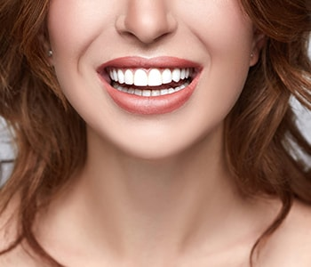 dentist discusses the costs and benefits of Pinhole Surgical treatment